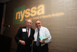 NYSSA board member A. Michael Lipper, CFA, with keynote speaker Leon Cooperman, CFA.