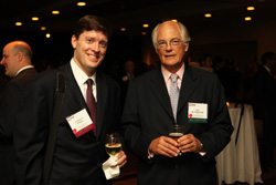 Garrett Evers of Thompson Hine LLP and NYSSA board member Guy Rutherfurd, CFA.